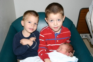 The boys are proud of their new sister.