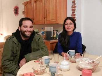 Federico Romero (left) and Karen Espejo (right) eating dinner at the John's house.