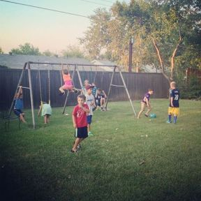 All the kids of the cousins playing in my mother's backyard.