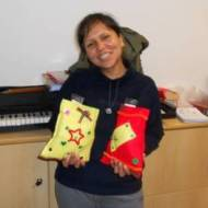 Pharmacist Elizabeth with two Christmas bags