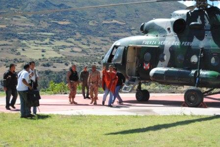 The President (with red poncho) leaving the helicopter. What a good thing that Udo Klemenz built this landing place.