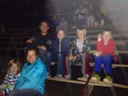 The kids with Austin, our missionary intern waiting for the show to start.