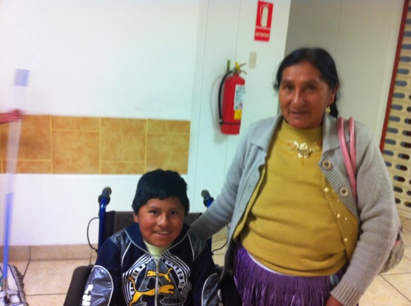 The young patient with his grandmother after learning his diagnosis.