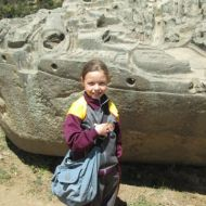 Annie in front of the monolith of Sayhuite