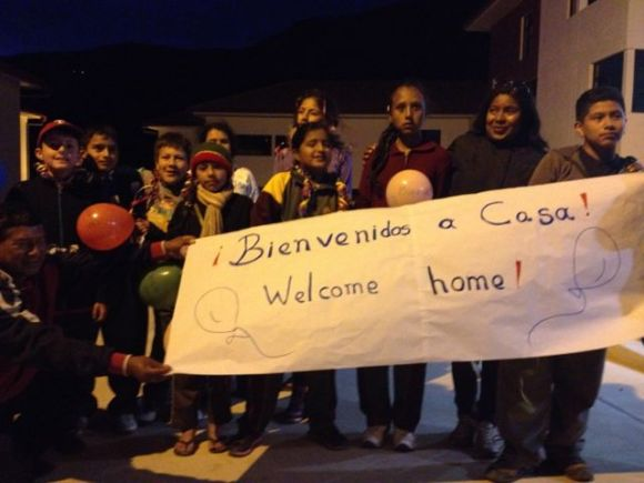 The parents welcomed their kids home with a sign and firecrackers.