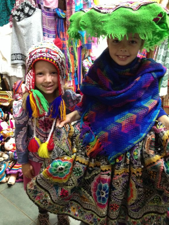 Sarah and Annie allow the pushy young ladies in the souvenir stores in Cusco to dress them in Quechua clothes.  I appreciate how kind these girls are to strangers and also how they both really like Peruvian culture.