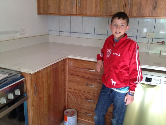 David in our shiny new kitchen the day we got our tile done. Yes, some pieces have already fallen off, but isn't the kitchen nice looking?