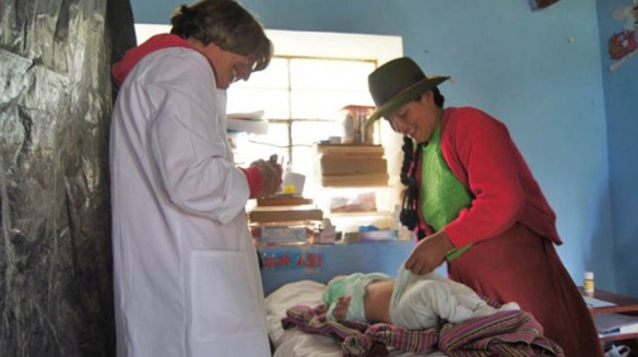 Pediatrician Dr. Martina John treats a Quechua child.
