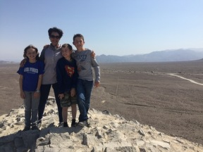 Allison and the kids standing on a hill with the lines extending straight behind them for miles.