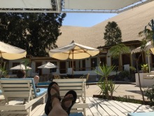 At the pool in the hotel. The giant sand dunes loom over the small hosteria.