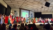 37 students representing their countries carrying their flags